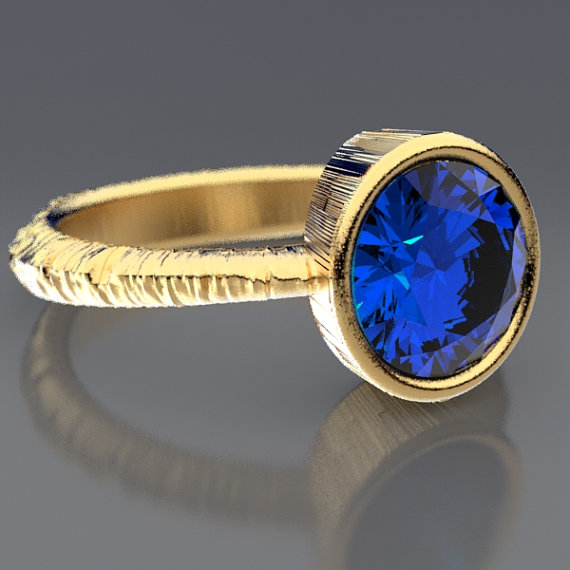 Josh Wendler's Aspen Bark 1.85 Carat Lab Created Sapphire Engagement Ring in Recycled Gold.